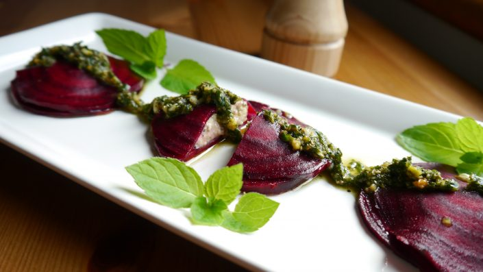 Beet Ravioli stuffed with Riccotta Cheese with pistachio mint pesto amrutha lounge